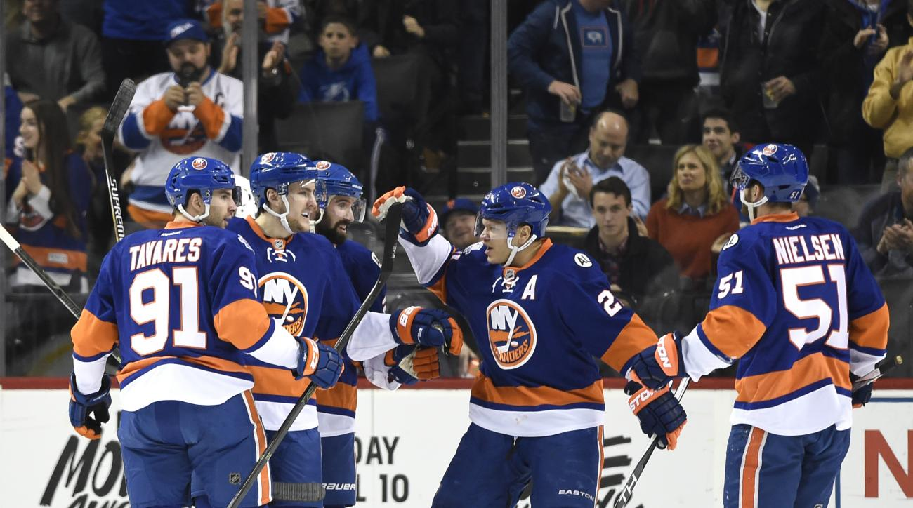 New York Islanders defenseman Ryan Pulock (6), second from left, celebrates his goal with center John Tavares (91), defenseman Nick Leddy (2), right wing Kyle Okposo (21) and center Frans Nielsen (51) in the first period of an NHL hockey game against the