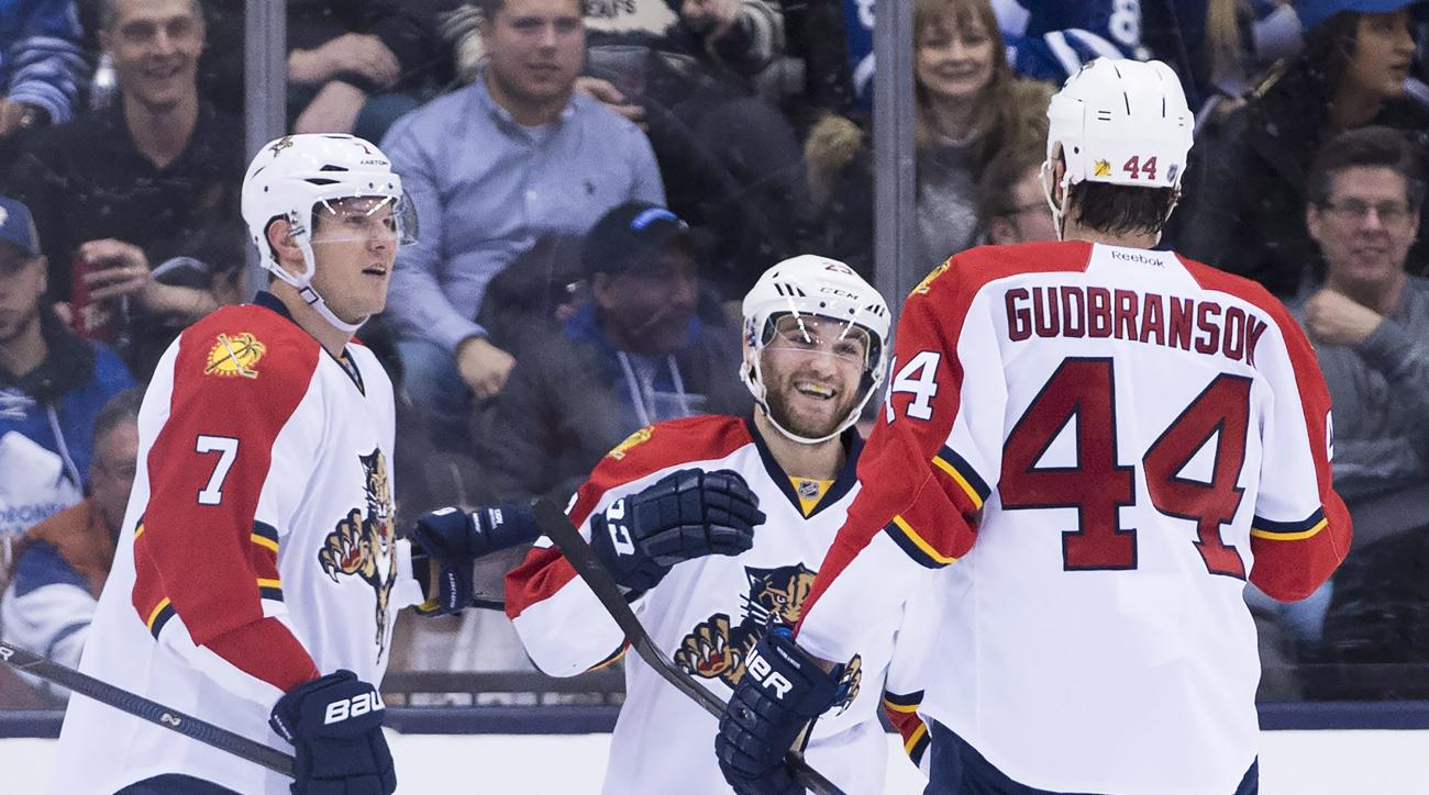 Florida Panthers center Rocco Grimaldi (23) celebrates with teammates Dmitry Kulikov (7) and Erik Gudbranson (44) after scoring against the Toronto Maple Leafs during second period NHL hockey action in Toronto on Monday, April 4, 2016. (Nathan Denette/The