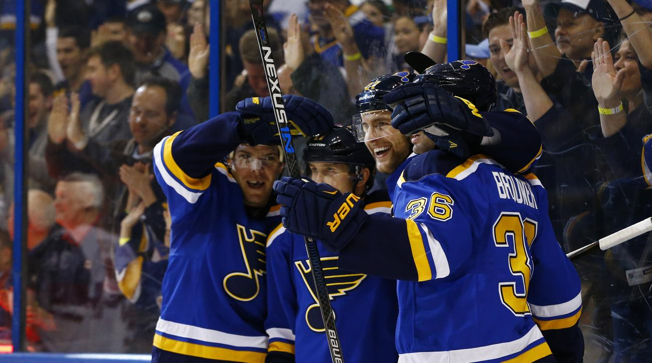 St. Louis Blues Alex Pietrangelo, third from left, celebrates with teammates Paul Stastny, left, Jaden Schwartz Troy Brouwer after scoring a goal during the second period of an NHL hockey game against the Arizona Coyotes, Monday, April 4, 2016, in St. Lou