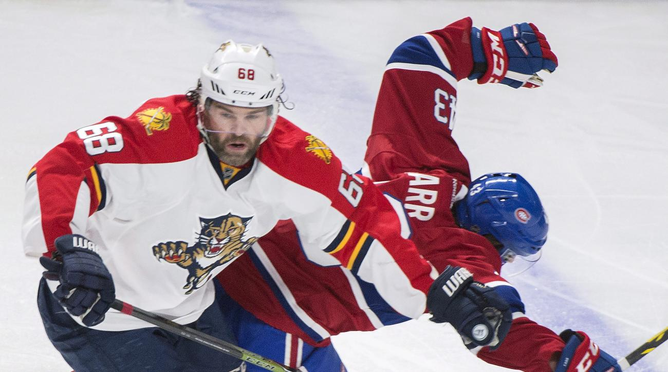 Montreal Canadiens' Daniel Carr, right, collides with Florida Panthers' Jaromir Jagr during the second period of an NHL hockey game Tuesday, April 5, 2016, in Montreal. (Graham Hughes/The Canadian Press via AP)
