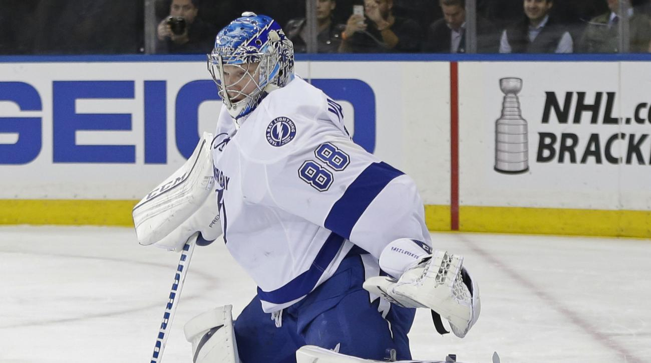 Tampa Bay Lightning goalie Andrei Vasilevskiy, of Russia, deflects a shot during the second period of an NHL hockey game against the New York Rangers on Tuesday, April 5, 2016, in New York. (AP Photo/Frank Franklin II)