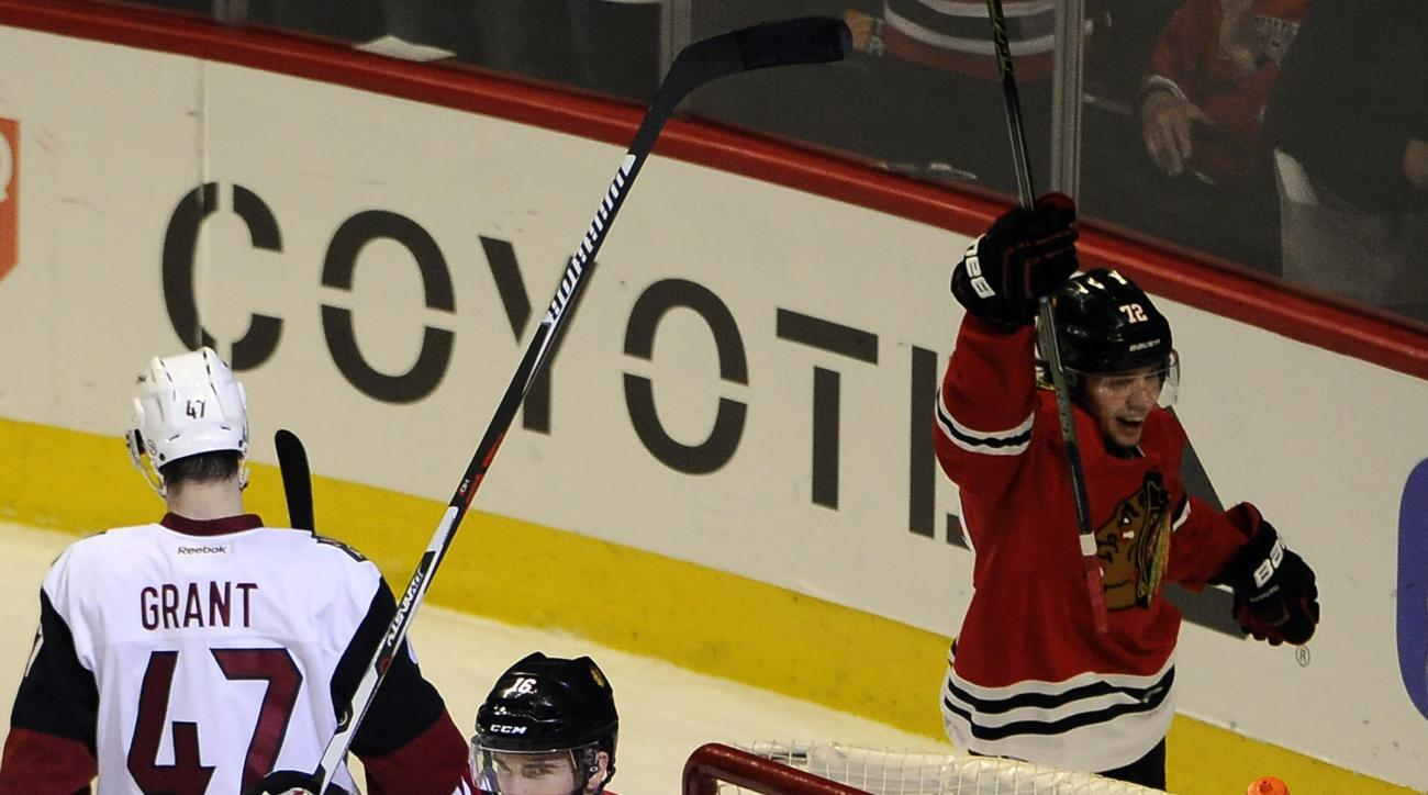 Chicago Blackhawks left wing Andrew Ladd (16) celebrates his goal in front of Arizona Coyotes goalie Louis Domingue (35) in the second period of an NHL hockey game Tuesday, April 5, 2016, in Chicago. (AP Photo/David Banks)
