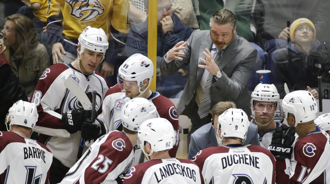 Colorado Avalanche coach Patrick Roy talks with his players during the third period of an NHL hockey game against the Nashville Predators on  Tuesday, April 5, 2016, in Nashville, Tenn. The Predators won 4-3. (AP Photo/Mark Humphrey)