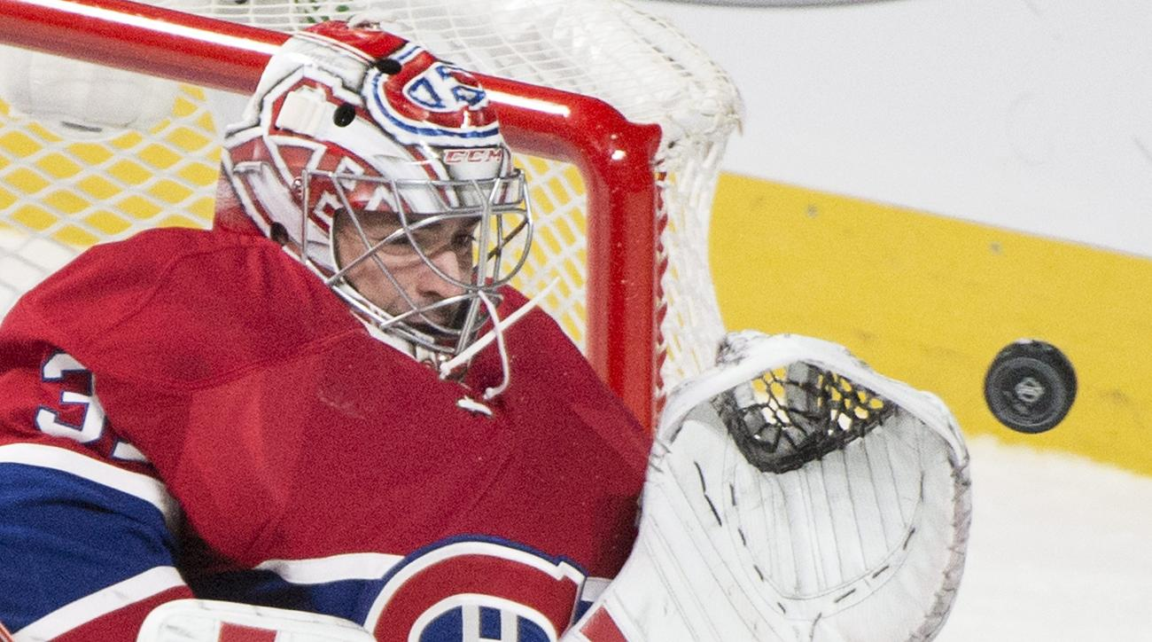 FILE - In this Oct. 20, 2015, file photo, Montreal Canadiens goaltender Carey Price makes a save against the St. Louis Blues during the third period of an NHL hockey game, in Montreal. The Montreal Canadiens say goaltender Carey Price and defenseman P.K.