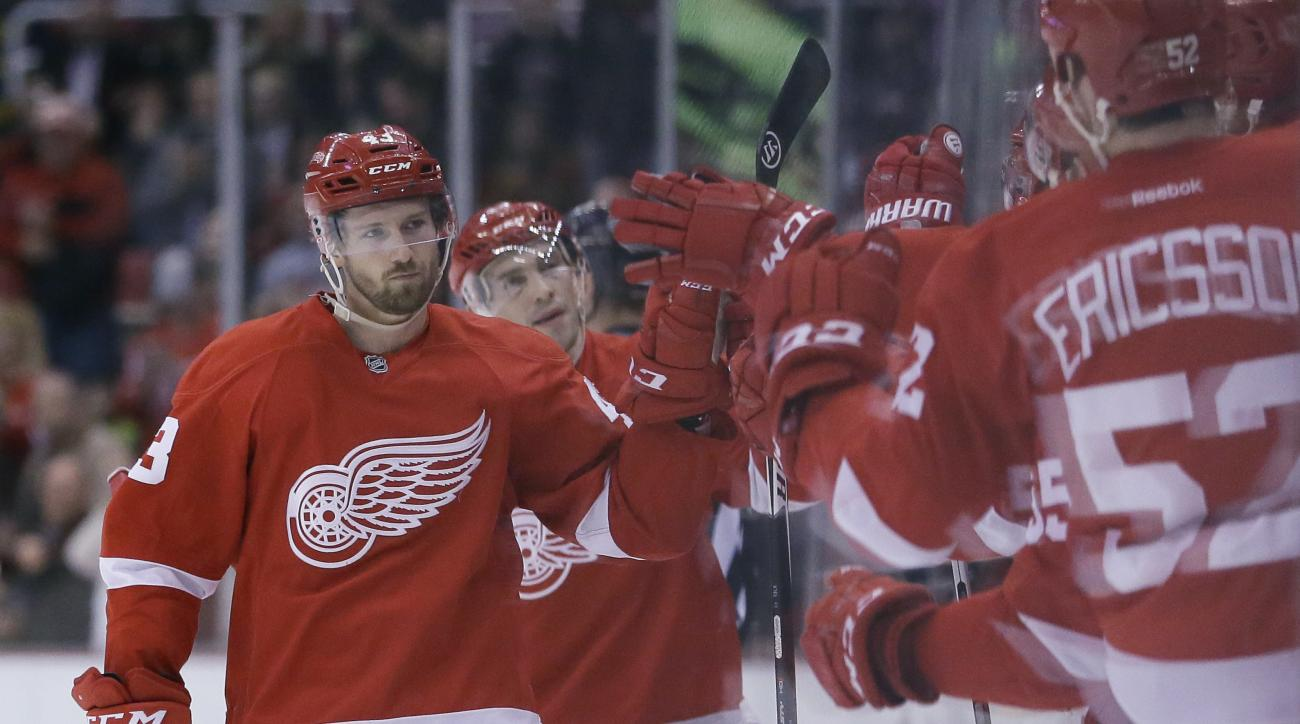 Detroit Red Wings center Darren Helm is congratulated by teammates after scoring during the first period of an NHL hockey game against the Philadelphia Flyers, Wednesday, April 6, 2016, in Detroit. (AP Photo/Carlos Osorio)