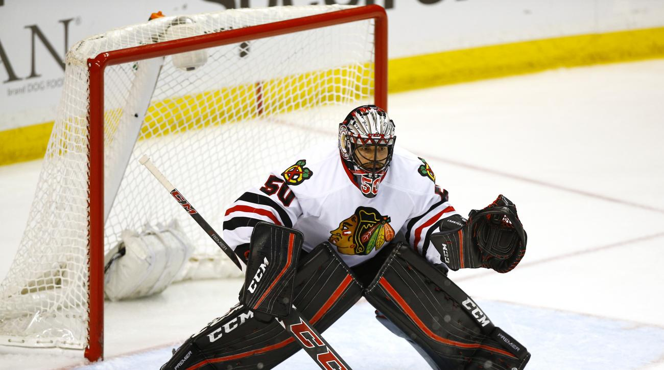 Chicago Blackhawks goalie Corey Crawford in action during an NHL hockey game against the St. Louis Blues, Wednesday, March 9, 2016, in St. Louis. The Blues won 3-2 in a shootout. (AP Photo/Billy Hurst)