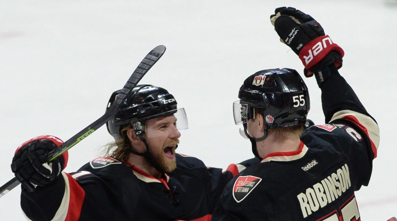 Ottawa Senators right wing Buddy Robinson , right, celebrates his first NHL goal with teammate Ottawa Senators defenseman Michael Kostka during the second period of an NHL hockey game, Thursday, April 7, 2016 in Ottawa, Ontario. (Sean Kilpatrick/The Canad