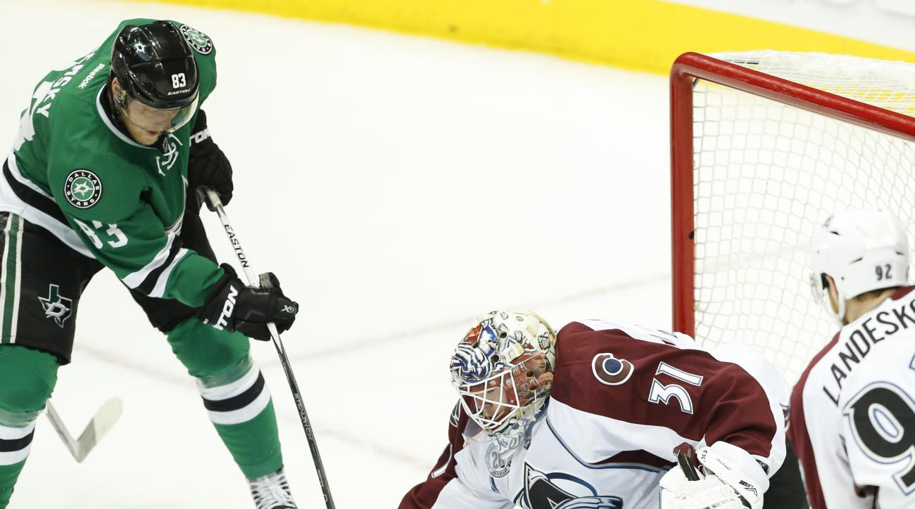 Colorado Avalanche goalie Calvin Pickard (31) blocks a shot on goal by Dallas Stars right wing Ales Hemsky (83) during the second period of an NHL hockey game, Thursday, April 7, 2016, in Dallas. (AP Photo/Jim Cowsert)