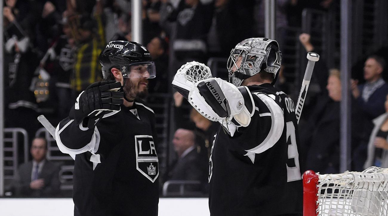 Los Angeles Kings defenseman Drew Doughty, left, and goalie Jonathan Quick congratulate each other after the Kings defeated the Anaheim Ducks 2-1 in an NHL hockey game, Thursday, April 7, 2016, in Los Angeles. (AP Photo/Mark J. Terrill)