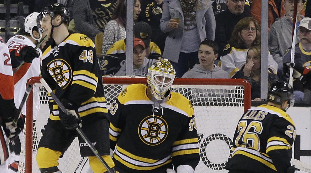 Boston Bruins goalie Jonas Gustavsson (50) reacts along with teammates defensemen Colin Miller (48) and John-Michael Liles (26) after the Ottawa Senators scored in the second period of an NHL hockey game, Saturday, April 9, 2016, in Boston. (AP Photo/Elis
