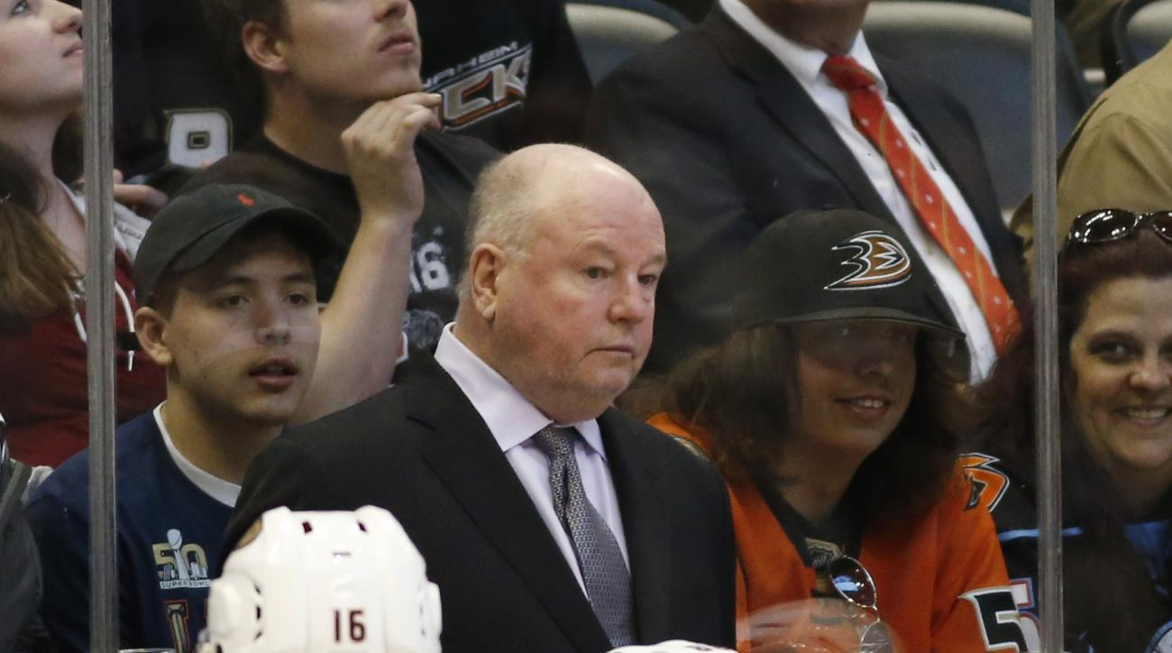 Anaheim Ducks head coach Bruce Boudreau, back, looks on against the Colorado Avalanche in the second period of an NHL hockey game Saturday, April 9, 2016, in Denver. (AP Photo/David Zalubowski)