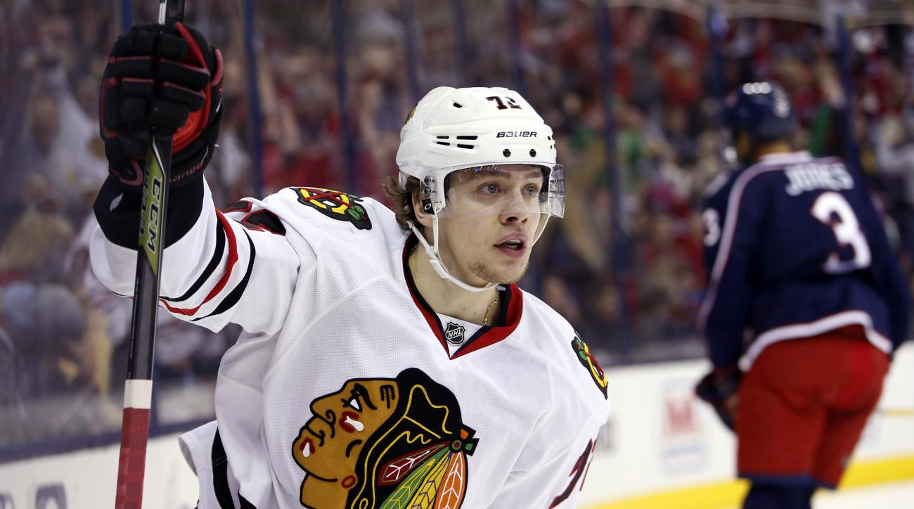 Chicago Blackhawks' Artemi Panarin, of Russia, celebrates his second goal against the Columbus Blue Jackets during the first period of an NHL hockey game Saturday, April 9, 2016, in Columbus, Ohio. (AP Photo/Jay LaPrete)