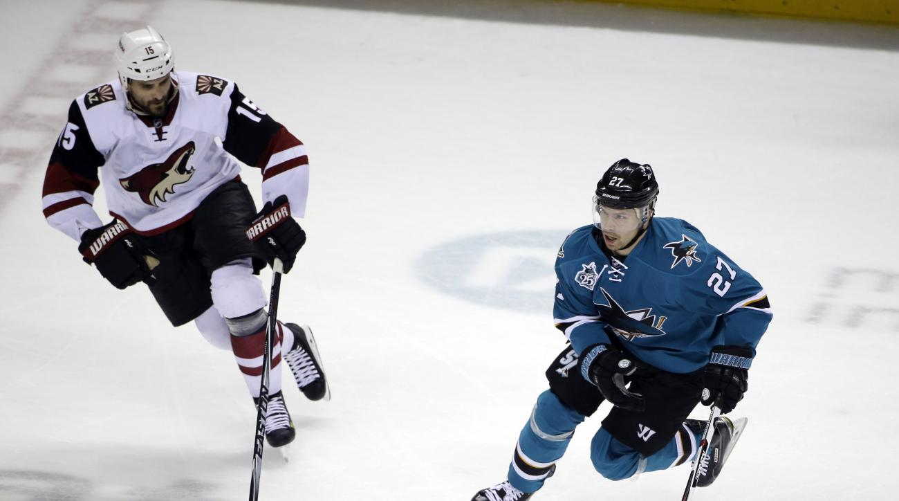 San Jose Sharks' Joonas Donskoi (27) is chased by Arizona Coyotes' Boyd Gordon (15) during the second period of an NHL hockey game Saturday, April 9, 2016, in San Jose, Calif. (AP Photo/Marcio Jose Sanchez)