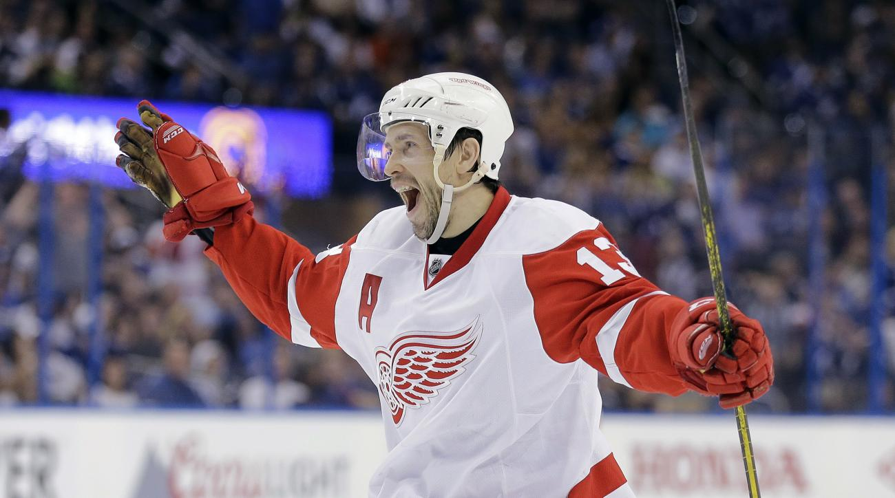 FILE - In this April 25, 2015, file photo, Detroit Red Wings center Pavel Datsyuk, of Russia, celebrates his goal against the Tampa Bay Lightning during the third period of Game 5 of a first-round NHL Stanley Cup hockey playoff series in Tampa, Fla. Datsy