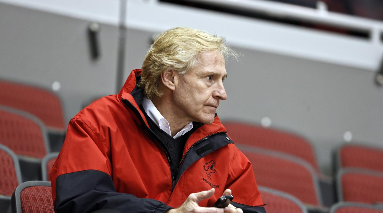 FILE - In this Jan, 15, 2013, file photo, Phoenix Coyotes general manager Don Maloney watches his team during  NHL hockey practice in Glendale, Ariz. The NHL rewarded Maloney on Friday, May 24, 2013, signing the him to a long-term contract that will keep