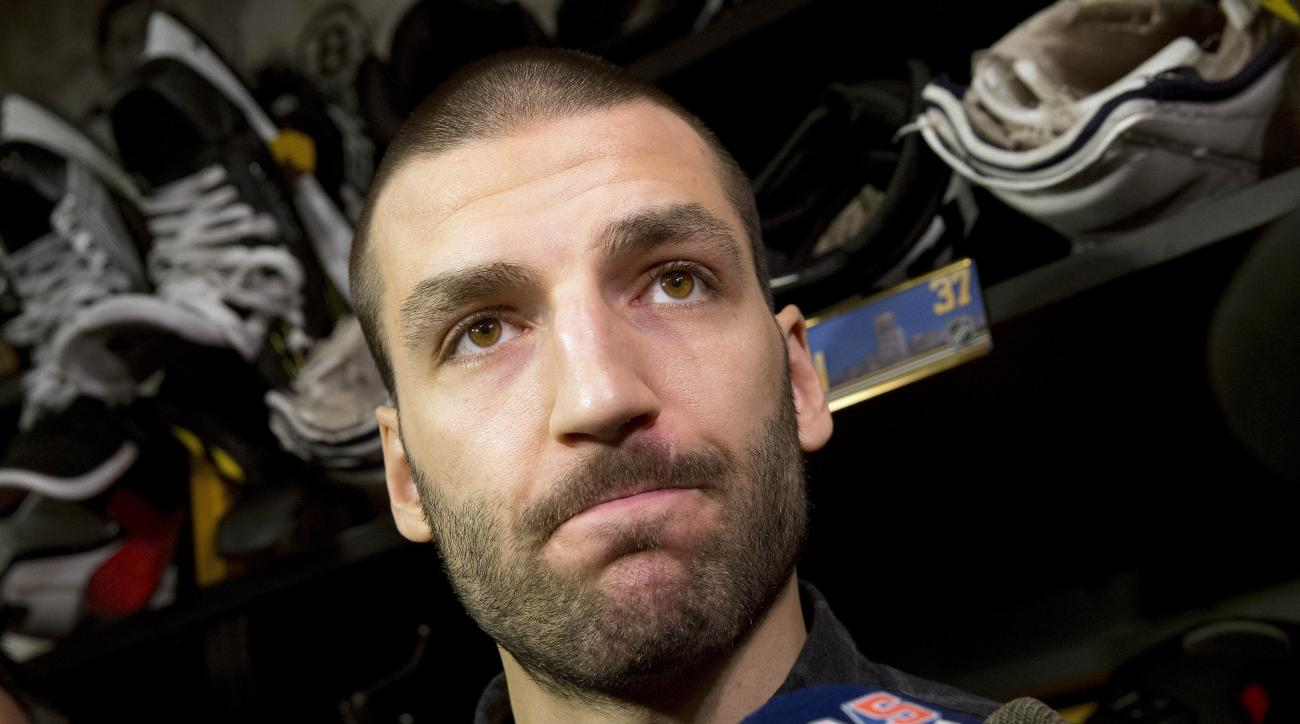 Boston Bruins' Patrice Bergeron speaks with reporters at TD Garden, Monday, April 11, 2016, in Boston following the team's final game of the NHL hockey season. (AP Photo/Michael Dwyer)