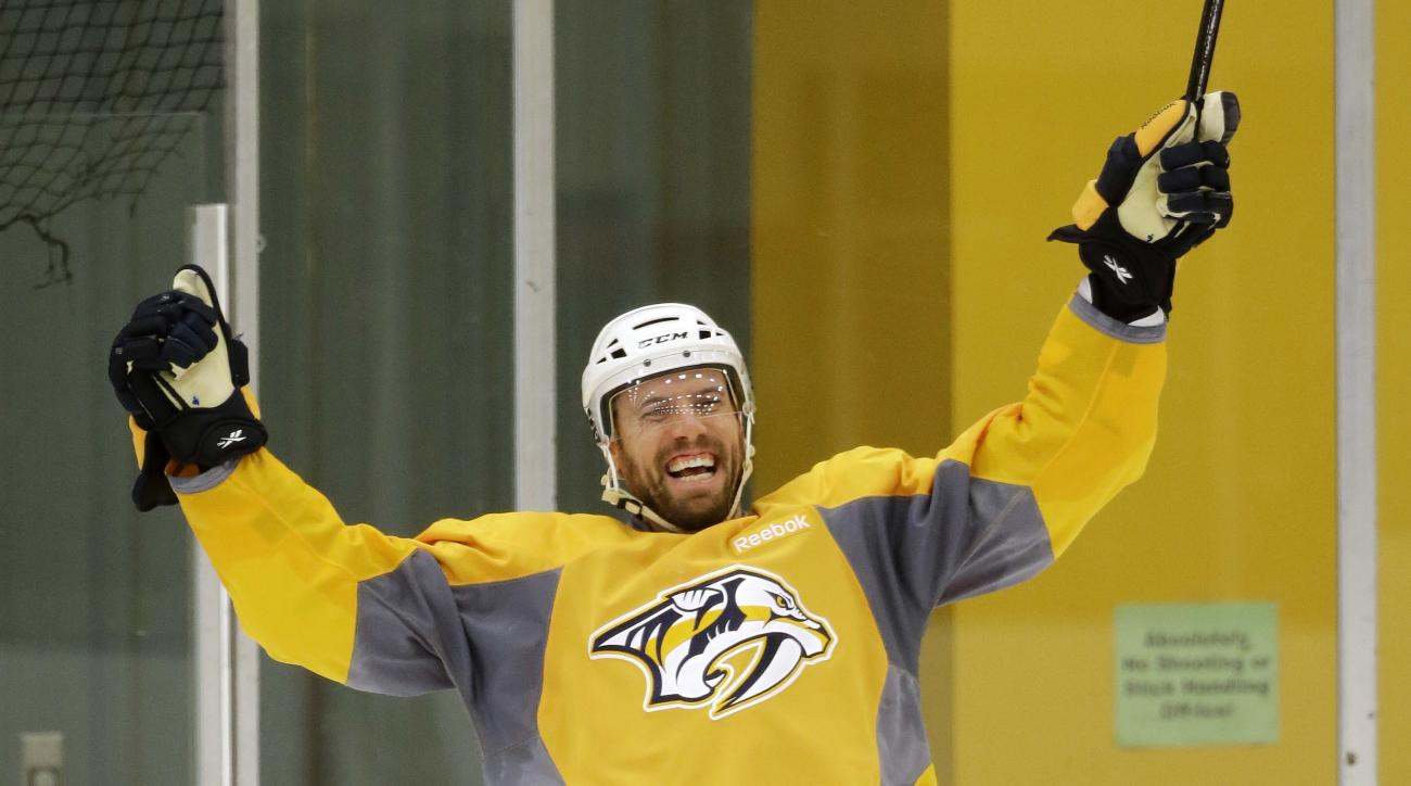 Nashville Predators defenseman Shea Weber celebrates a teammate's shot during practice Tuesday, April 12, 2016, in Nashville, Tenn. The Predators are scheduled to play the Anaheim Ducks in the first round of the NHL Western Conference hockey playoffs Frid