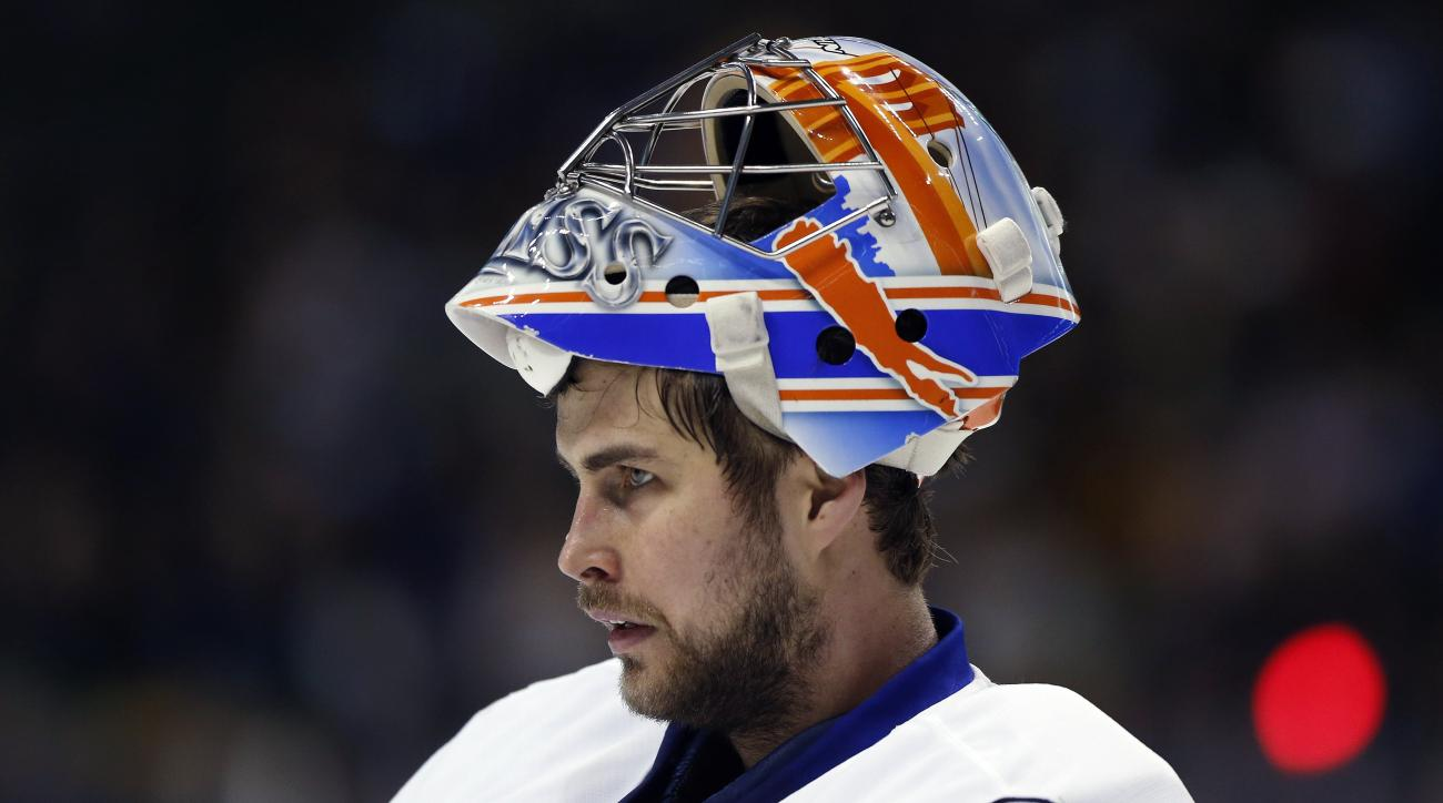 FILE - In this March 12, 2016, file photo, New York Islanders goalieThomas Greiss pauses during the team's NHL hockey game against the Boston Bruins in Boston. Greiss has received the bulk of the starts after starting goalie Jarsolav Halak was injured las