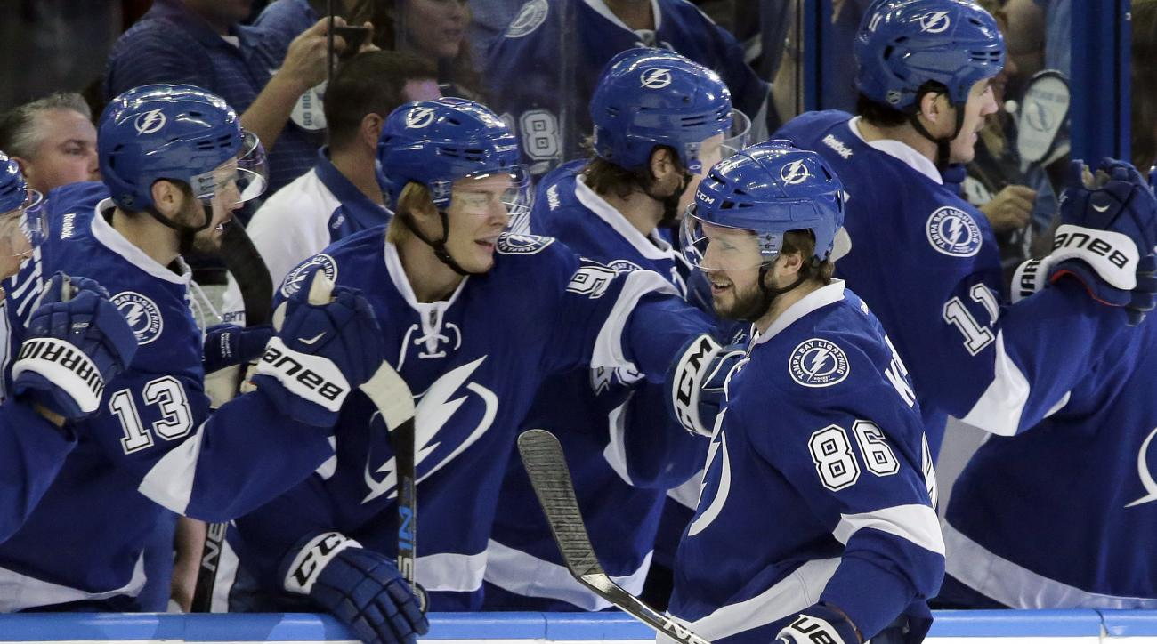 Tampa Bay Lightning right wing Nikita Kucherov (86), of Russia, celebrates with the bench after scoring against the Detroit Red Wings during the first period of Game 1 in a first-round NHL hockey Stanley Cup playoff series Wednesday, April 13, 2016, in Ta