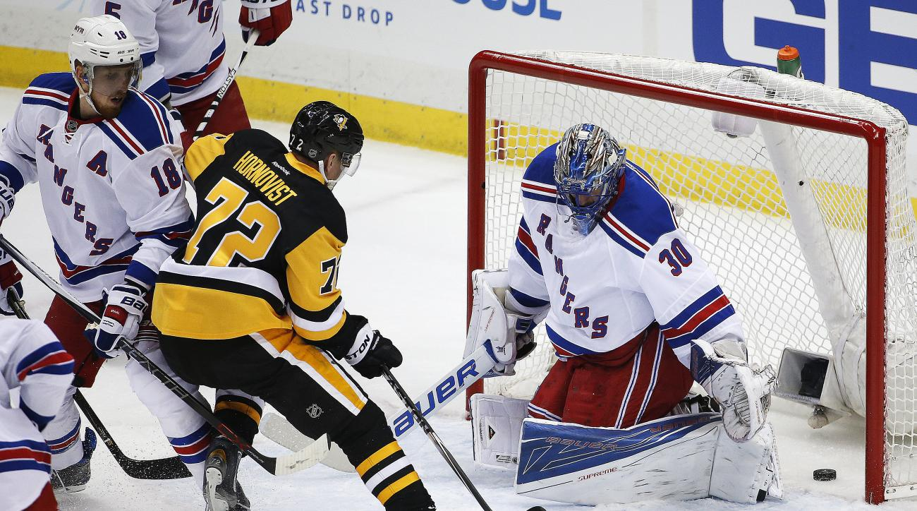 Pittsburgh Penguins' Patric Hornqvist (72) gets the puck past New York Rangers goalie Henrik Lundqvist (30) for a goal during the first period of a first-round NHL playoff hockey game in Pittsburgh, Wednesday, April 13, 2016. (AP Photo/Gene J. Puskar)