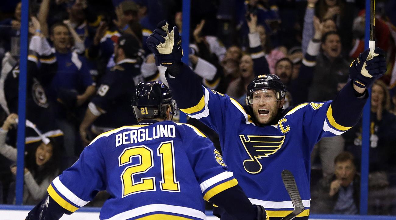 St. Louis Blues' David Backes, right, is congratulated by Patrik Berglund, of Sweden, after scoring during overtime in Game 1 of an NHL hockey first-round Stanley Cup playoff series against the Chicago Blackhawks on Wednesday, April 13, 2016, in St. Louis