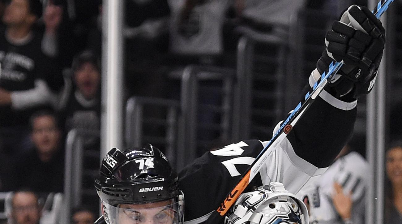 Los Angeles Kings left wing Dwight King, left, celebrates a goal by center Trevor Lewis as he runs into San Jose Sharks goalie Martin Jones during the second period of Game 1 in an NHL hockey Stanley Cup playoffs first-round series, Thursday, April 14, 20