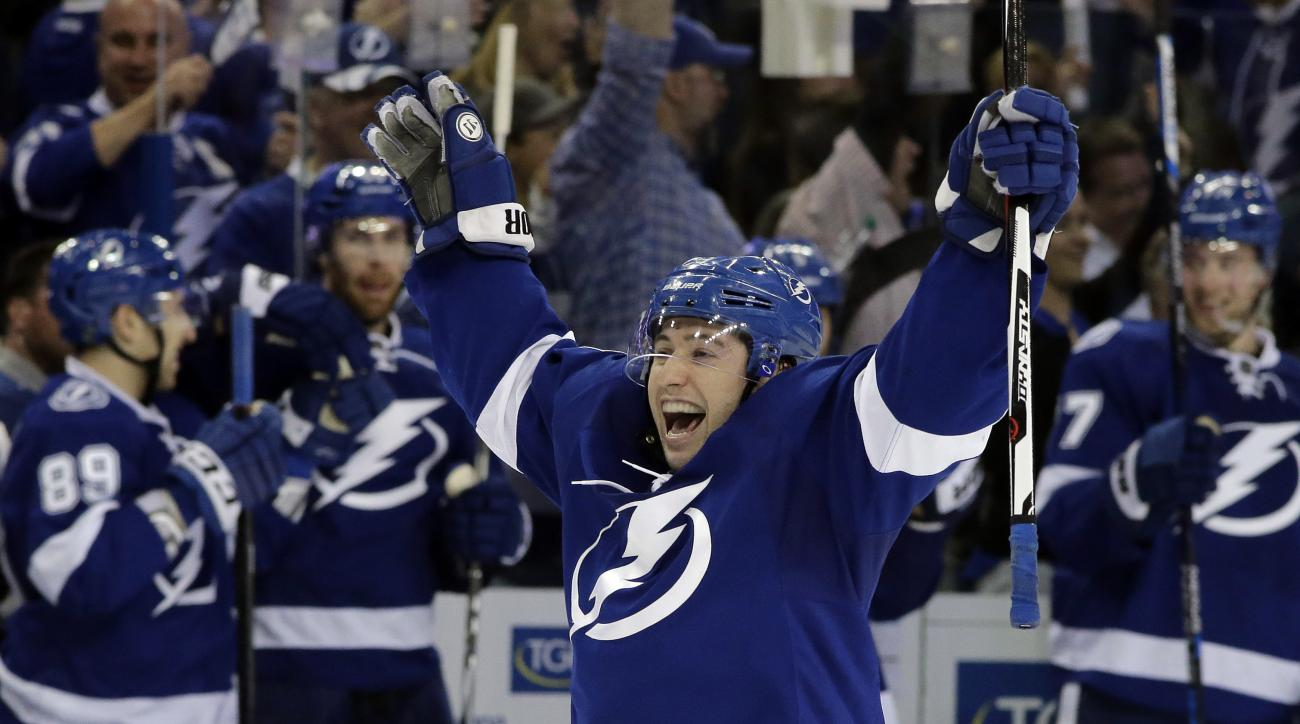 Tampa Bay Lightning center Tyler Johnson celebrates a goal by Alex Killorn during the third period of Game 2 in a first-round NHL hockey Stanley Cup playoff series Friday, April 15, 2016, in Tampa, Fla. Johnson had two goals in the game, which Tampa Bay w
