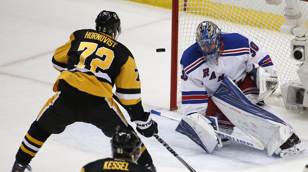 New York Rangers goalie Henrik Lundqvist (30) stops a shot by Pittsburgh Penguins' Patric Hornqvist (72) during the first period in Game 2 in the first round of the NHL Stanley Cup playoffs in Pittsburgh, Saturday, April 16, 2016. (AP Photo/Gene J. Puskar