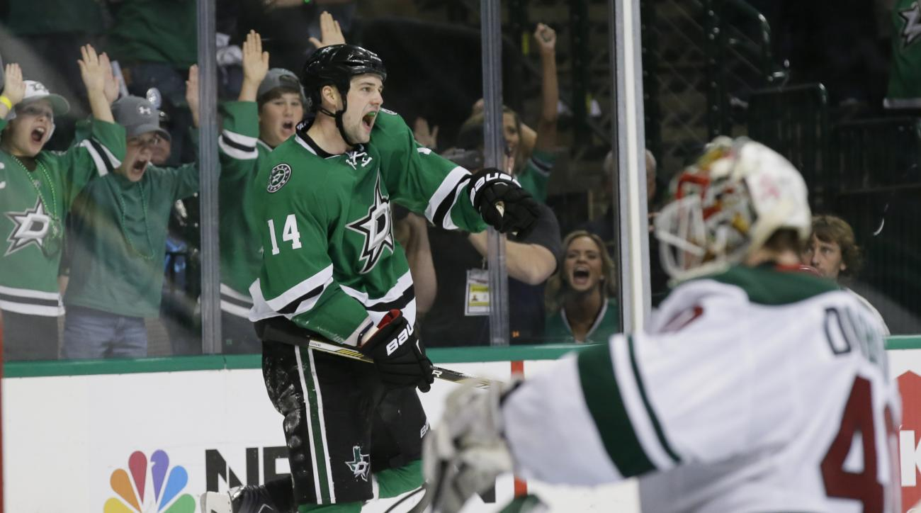 Dallas Stars left wing Jamie Benn (14) celebrates his goal against Minnesota Wild goalie Devan Dubnyk (40) during the third period in Game 2 in the first round of the NHL Stanley Cup playoffs Saturday, April 16, 2016, in Dallas. (AP Photo/LM Otero)