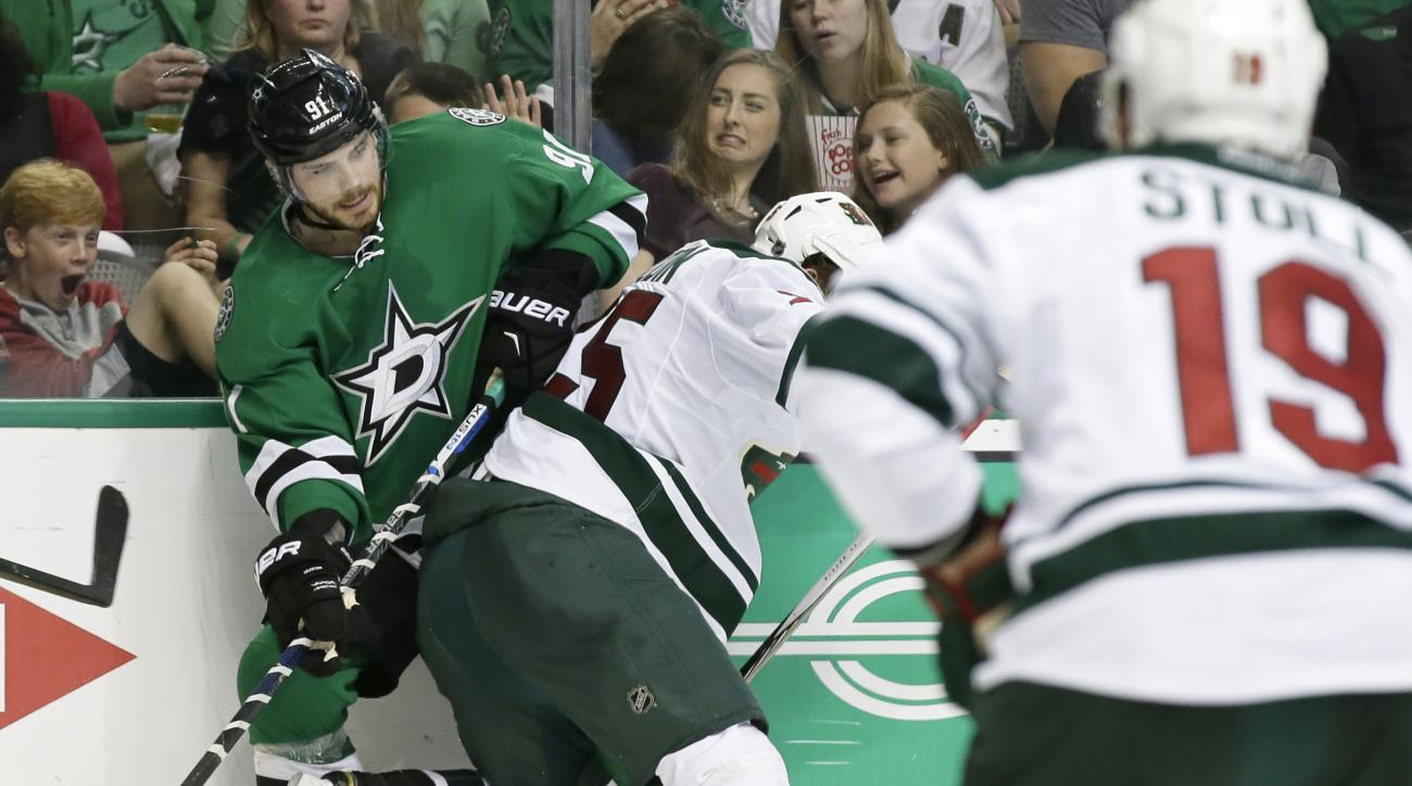 Dallas Stars center Tyler Seguin (91) tangles with Minnesota Wild defenseman Jonas Brodin (25) for the control of the puck during the third period in Game 2 in the first round of the NHL Stanley Cup playoffs Saturday, April 16, 2016, in Dallas. (AP Photo/