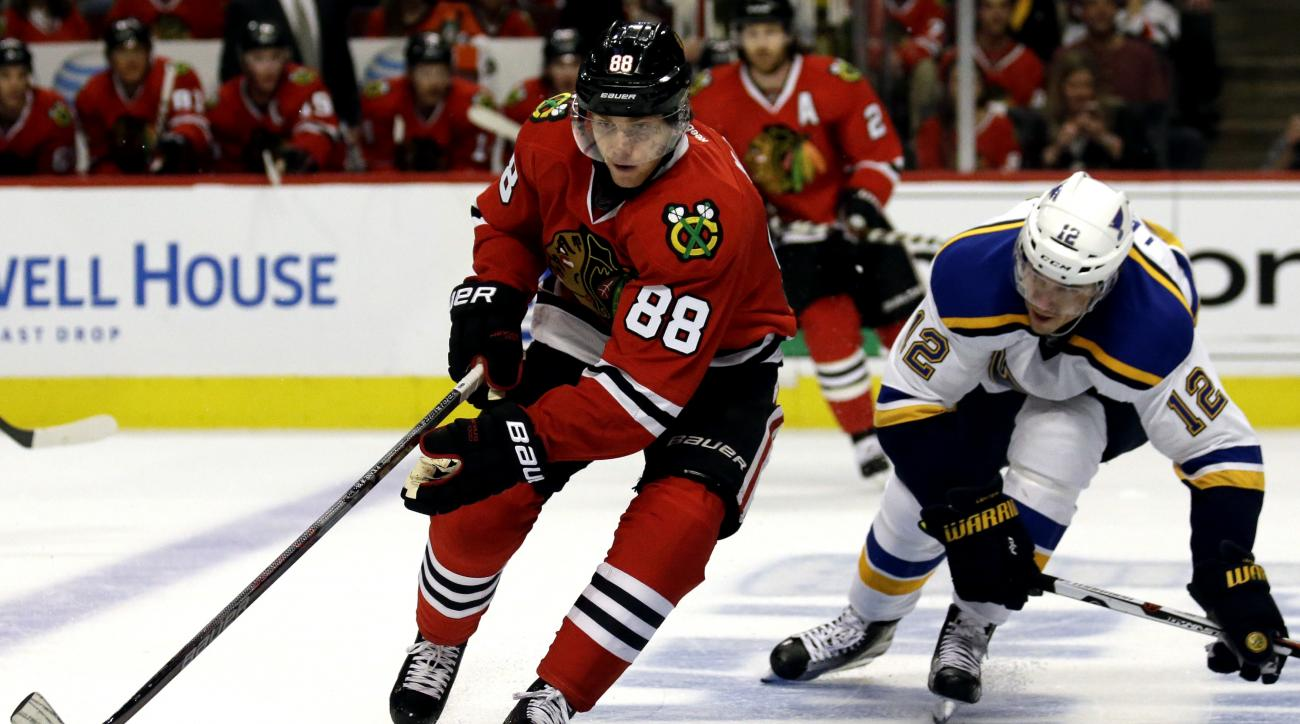 Chicago Blackhawks right wing Patrick Kane, left, controls the puck against St. Louis Blues center Jori Lehtera during the second period in Game 3 of an NHL hockey first-round Stanley Cup playoff series, Sunday, April 17, 2016, in Chicago. (AP Photo/Nam Y