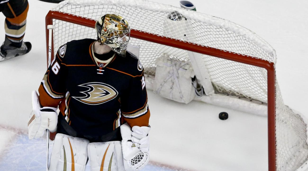 Anaheim Ducks goalie John Gibson looks at Nashville Predators' Mattias Ekholm's goal during the first period of Game 2 in an NHL hockey Stanley Cup playoffs first-round series in Anaheim, Calif., Sunday, April 17, 2016. (AP Photo/Chris Carlson)