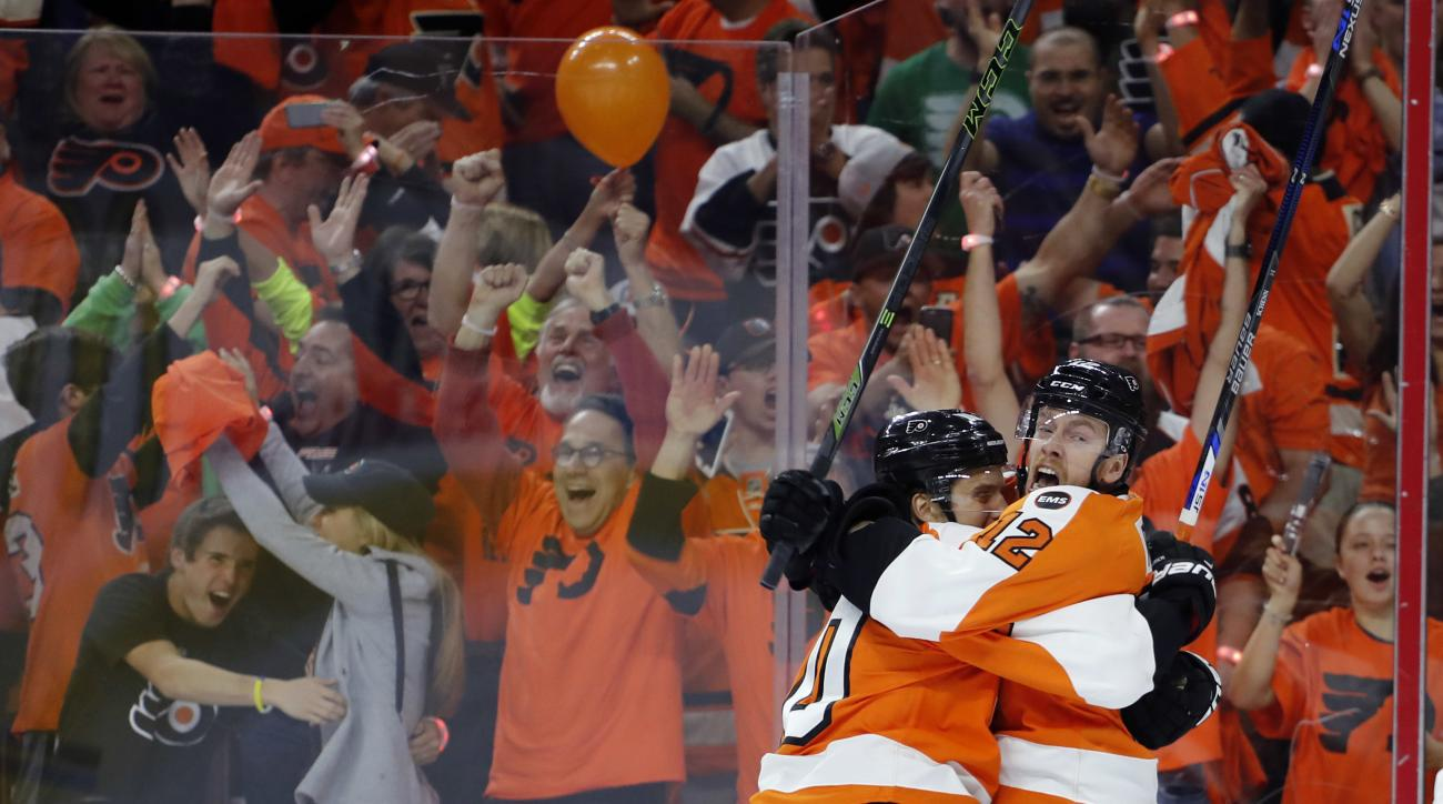 Philadelphia Flyers' Michael Raffl, right, and Brayden Schenn celebrate after Raffl's goal during the first period of Game 3 in the first round of the NHL Stanley Cup hockey playoffs against the Washington Capitals, Monday, April 18, 2016, in Philadelphia