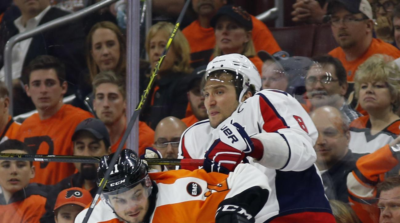 Philadelphia Flyers' Scott Laughton, left, and Washington Capitals' Alex Ovechkin collide during the second period of Game 3 in the first round of the NHL Stanley Cup hockey playoffs, Monday, April 18, 2016, in Philadelphia. (AP Photo/Matt Slocum)