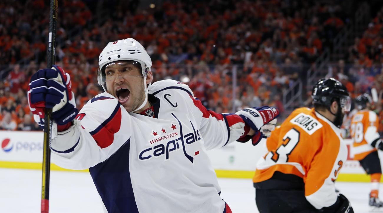 Washington Capitals' Alex Ovechkin, left, celebrates past Philadelphia Flyers' Radko Gudas after scoring a goal during the second period of Game 3 in the first round of the NHL Stanley Cup hockey playoffs, Monday, April 18, 2016, in Philadelphia. (AP Phot