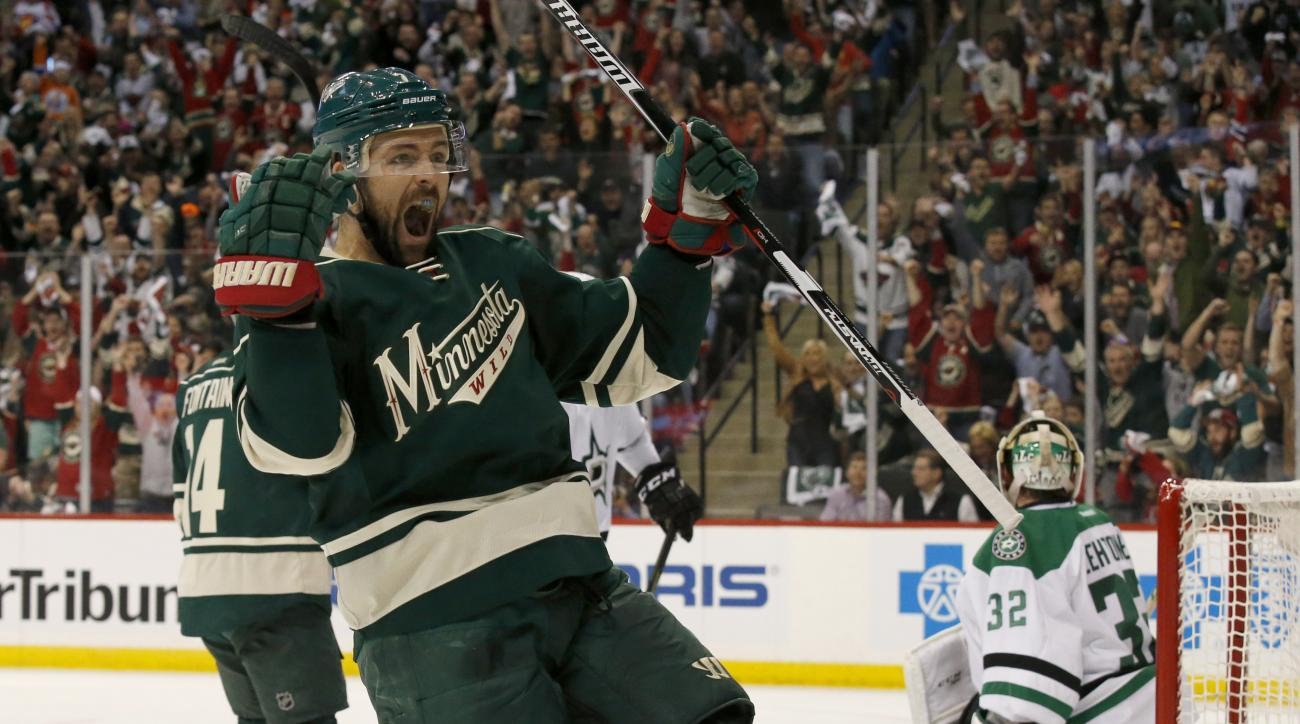Minnesota Wild left wing Chris Porter (7) celebrates after scoring on Dallas Stars goalie Kari Lehtonen (32) during the first period of Game 3 in the first round of the NHL Stanley Cup playoffs in St. Paul, Minn., Monday, April 18, 2016. (AP Photo/Ann Hei