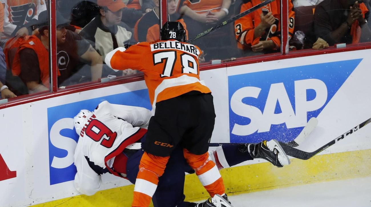 Philadelphia Flyers' Pierre-Edouard Bellemare (78) collides with Washington Capitals' Dmitry Orlov (9) during the third period of Game 3 in the first round of the NHL Stanley Cup hockey playoffs, Monday, April 18, 2016, in Philadelphia. Washington won 6-1