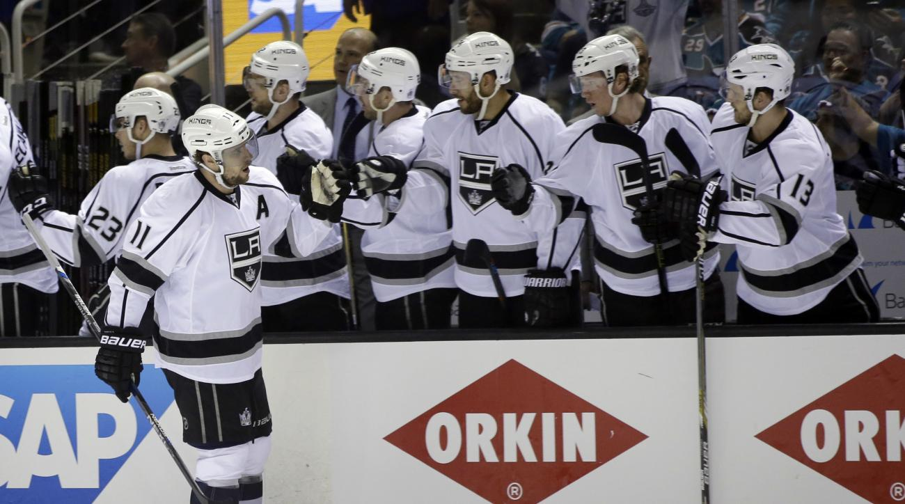 Los Angeles Kings' Anze Kopitar (11) celebrates his goal with teammates on the bench during the first period of Game 3 of an NHL hockey first-round Stanley Cup playoff series against the San Jose Sharks Monday, April 18, 2016, in San Jose, Calif. (AP Phot