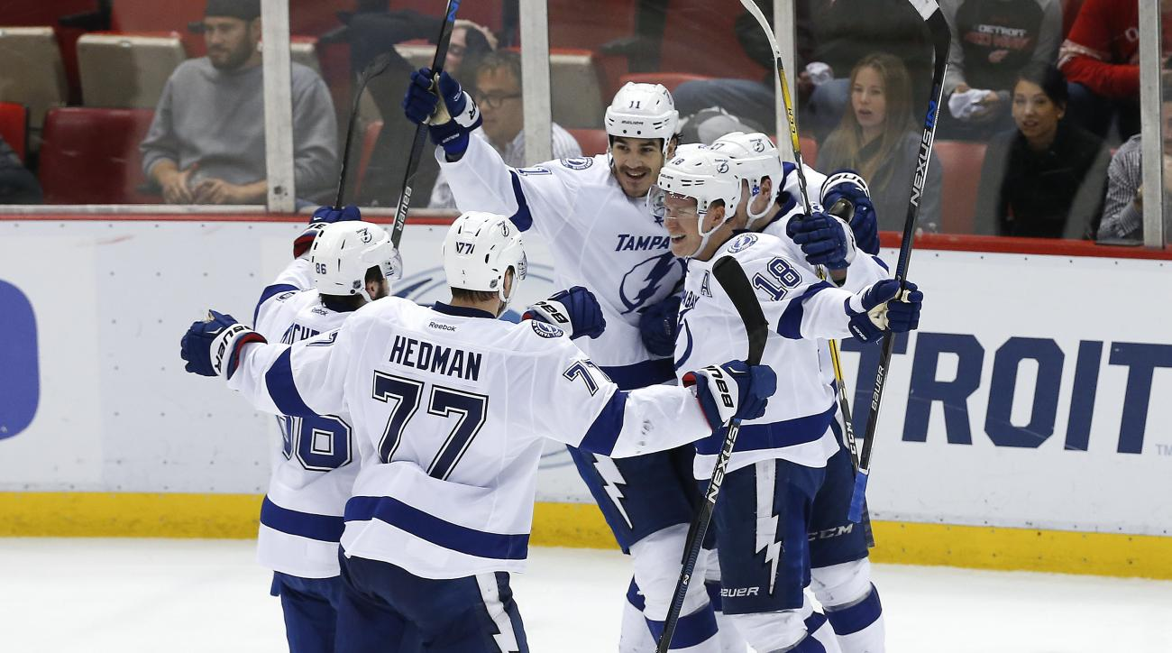 Tampa Bay Lightning left wing Ondrej Palat (18) celebrates his goal against the Detroit Red Wings during the third period of Game 4 in a first-round NHL hockey Stanley Cup playoff series, Tuesday, April 19, 2016, in Detroit. Tampa Bay won 3-2. (AP Photo/P