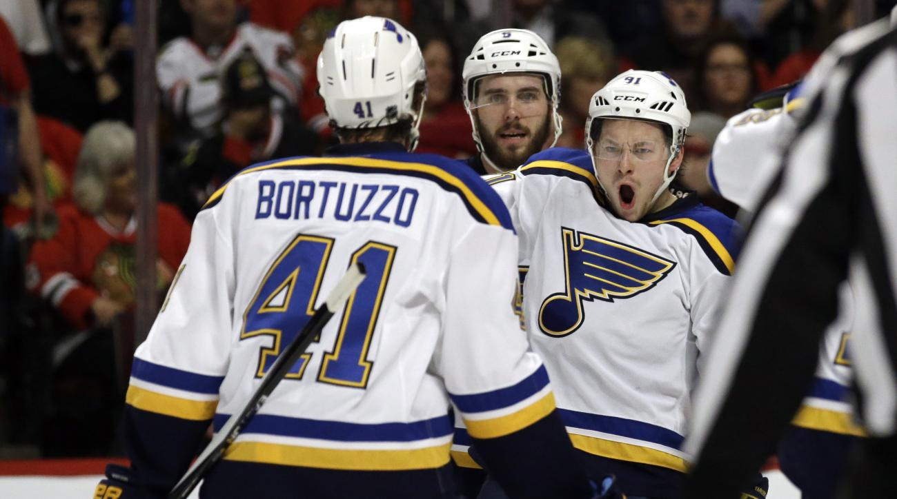 St. Louis Blues right wing Vladimir Tarasenko, right, celebrates with his teammates after scoring a goal against the Chicago Blackhawks during the first period in Game 4 of an NHL hockey first-round Stanley Cup playoff series Tuesday, April 19, 2016, in C