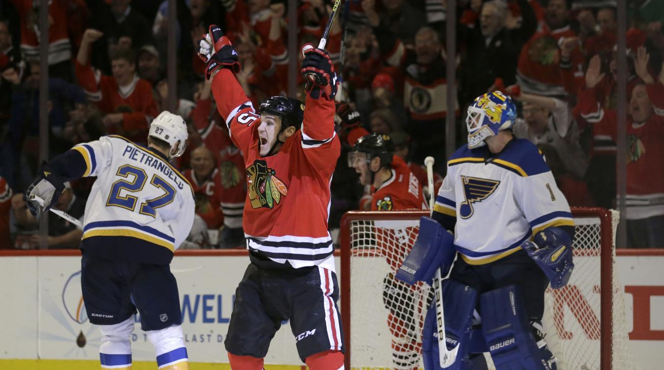 Chicago Blackhawks center Andrew Shaw (65) celebrates after scoring a goal against St. Louis Blues goalie Brian Elliott, right, during the second period in Game 4 of an NHL hockey first-round Stanley Cup playoff series Tuesday, April 19, 2016, in Chicago.