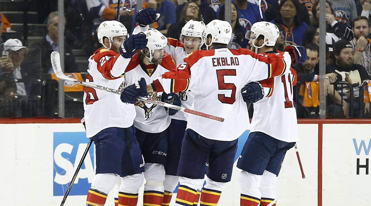 The Florida Panthers celebrate a second-period power-play goal against the New York Islanders in Game 4 of an NHL hockey first-round Stanley Cup playoff series, Wednesday, April 20, 2016, in New York. (AP Photo/Julie Jacobson)