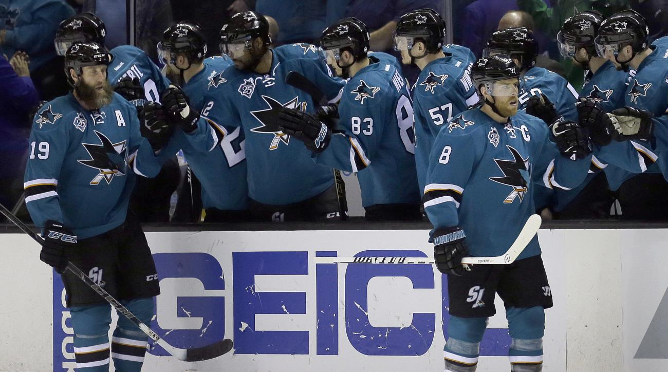 San Jose Sharks' Joe Pavelski, right, and Joe Thornton (19) are congratulated after Pavelski's goal against the Los Angeles Kings during the second period of Game 4 of an NHL hockey first-round Stanley Cup playoff series Wednesday, April 20, 2016, in San