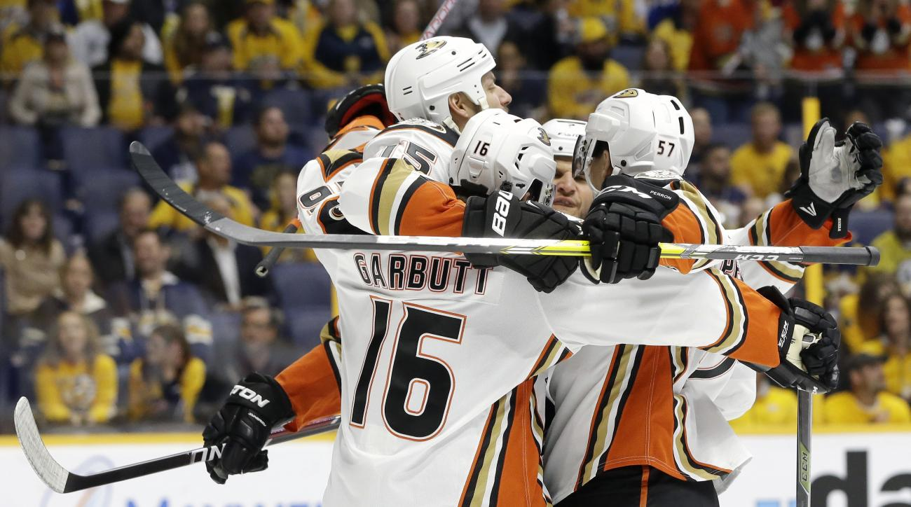 Anaheim Ducks center Ryan Getzlaf, top left, celebrates with Ryan Garbutt (16) and David Perron (57) after Getzlaf scored a goal against the Nashville Predators during the first period of Game 4 in an NHL hockey first-round Stanley Cup playoff series Thur