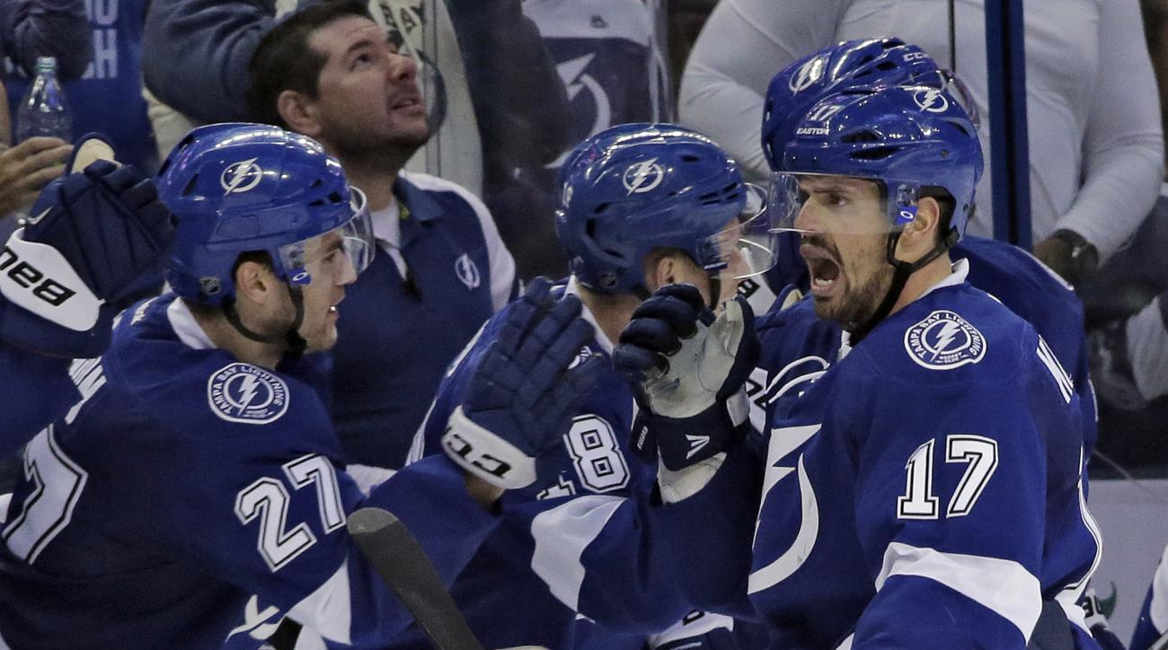 Tampa Bay Lightning center Alex Killorn (17) celebrates his goal against the Detroit Red Wings with the bench during the third period of Game 5 in a first-round NHL hockey Stanley Cup playoff series Thursday, April 21, 2016, in Tampa, Fla. The Lightning w