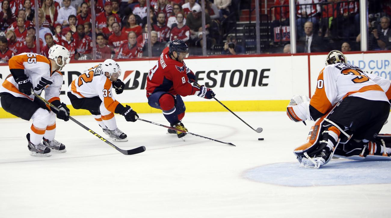Washington Capitals left wing Alex Ovechkin (8), from Russia, prepares a shot that was then stopped by Philadelphia Flyers goalie Michal Neuvirth (30), from the Czech Republic, during the second period of Game 5 in the first round of the NHL Stanley Cup h
