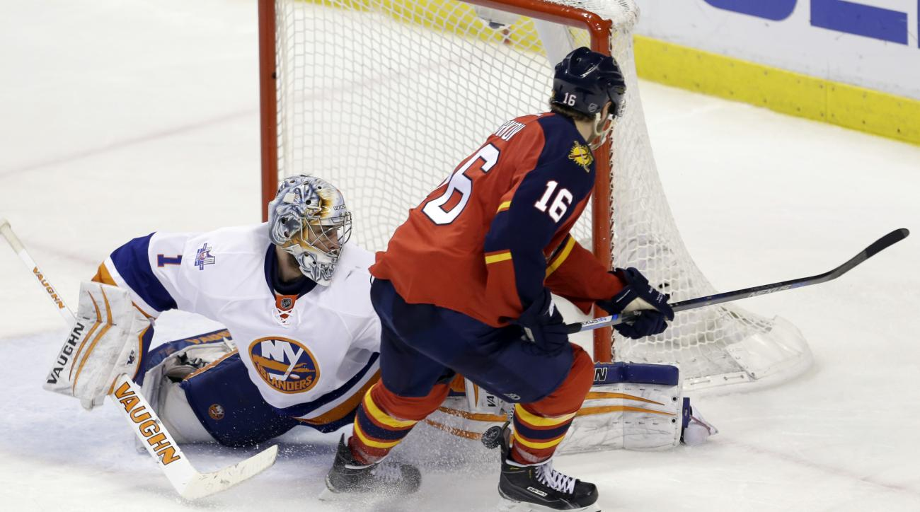 Florida Panthers goalie Roberto Luongo (1) blocks a penalty shot by Florida Panthers center Aleksander Barkov (16) in overtime period of Game 5 of an NHL hockey first-round Stanley Cup playoff series, Friday, April 22, 2016, in Sunrise, Fla. (AP Photo/Ala