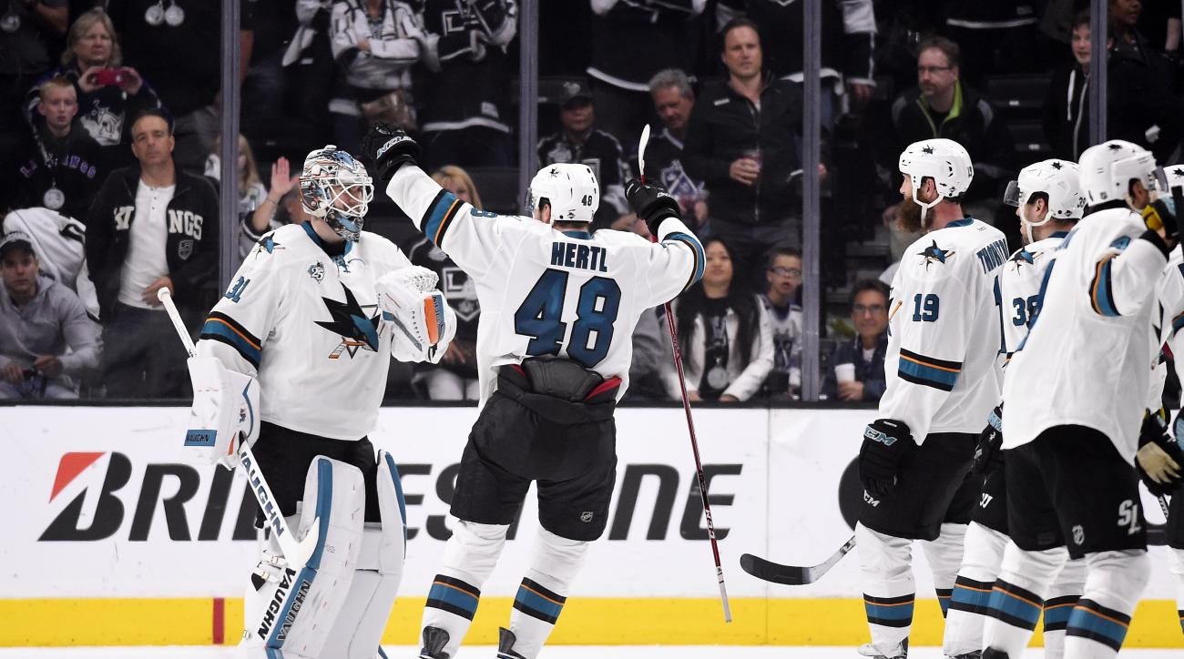 San Jose Sharks goalie Martin Jones, left, celebrates with center Tomas Hertl, center, of the Czech Republic, and other teammates after Game 5 in an NHL hockey Stanley Cup playoffs first-round series against the Los Angeles Kings, Friday, April 22, 2016,