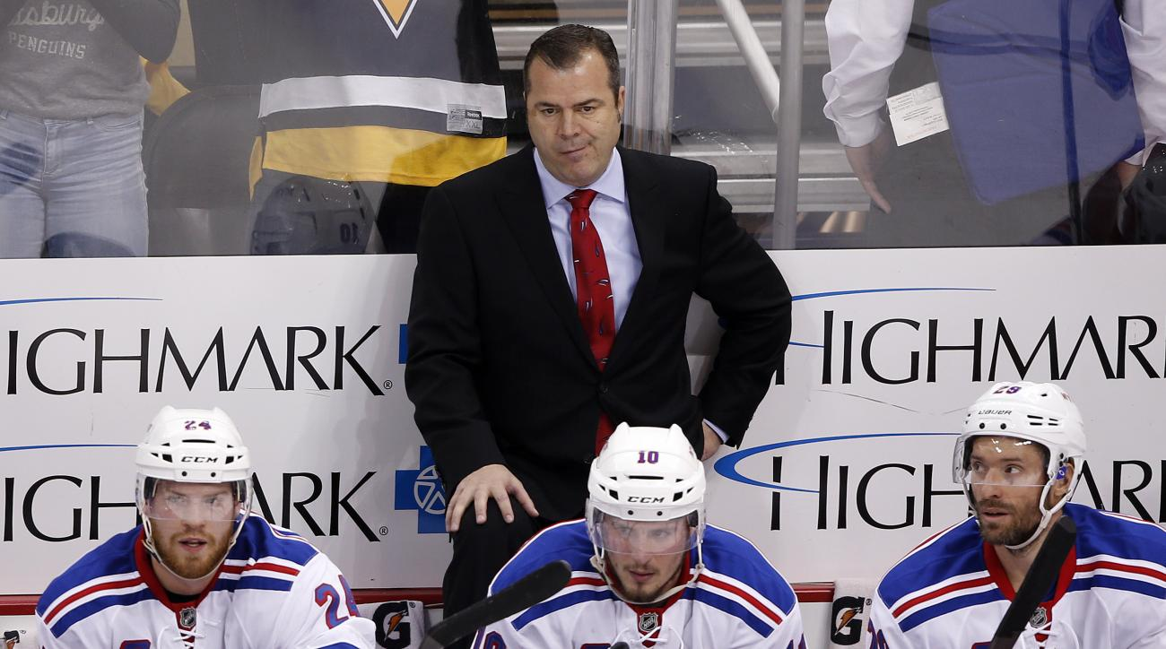 New York Rangers head coach Alain Vigneault stands behind his bench during the final minute of the third period in Game 5 of a first-round NHL playoff hockey game against the Pittsburgh Penguins in Pittsburgh, Saturday, April 23, 2016. The Penguins won 6-