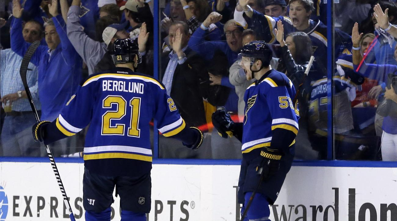 St. Louis Blues' Colton Parayko, right, is congratulated by teammate Patrik Berglund, of Sweden, after scoring during the first period in Game 7 of an NHL hockey first-round Stanley Cup playoff series against the Chicago Blackhawks Monday, April 25, 2016,